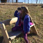girl sitting with binoculars