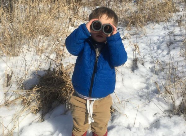 winter kid with binoculars